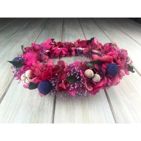 Coronita de flores preservadas fucsia